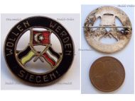 Austria Hungary WW1 Cap Badge with the Central Powers Flags Inscribed We Want to and We Will Win